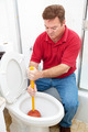 Man Uses Plunger on Clogged Toilet - PhotoDune Item for Sale