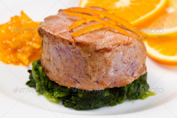 PhotoDune fried tuna fillet with fresh orange orange sauce and spinach 3794991
