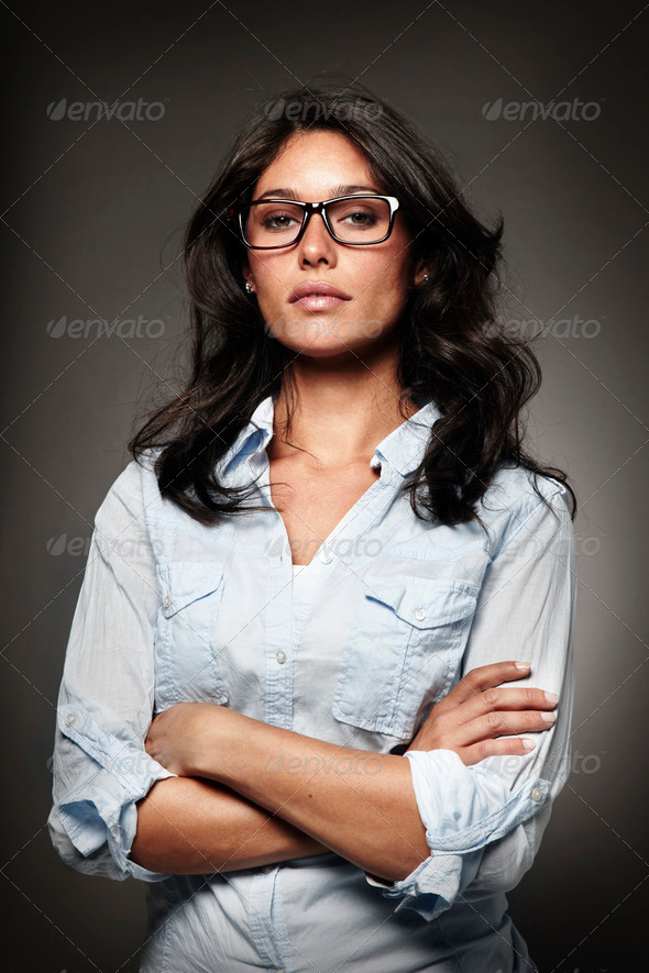 portrait of a modern woman with horn-rimmed glasses - Stock Photo - Images