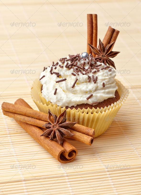 chocolate cupcake with whipped cream and cinnamon - Stock Photo - Images