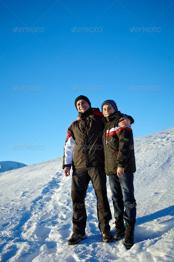 Father and son in winter holiday - Stock Photo - Images