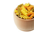 Wooden bowl of tricolor fusilli pasta isolated over white backgr - PhotoDune Item for Sale