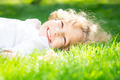 Child lying on grass - PhotoDune Item for Sale