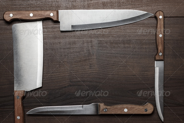 PhotoDune Kitchen Knifes On The Brown Wooden Table 3826770