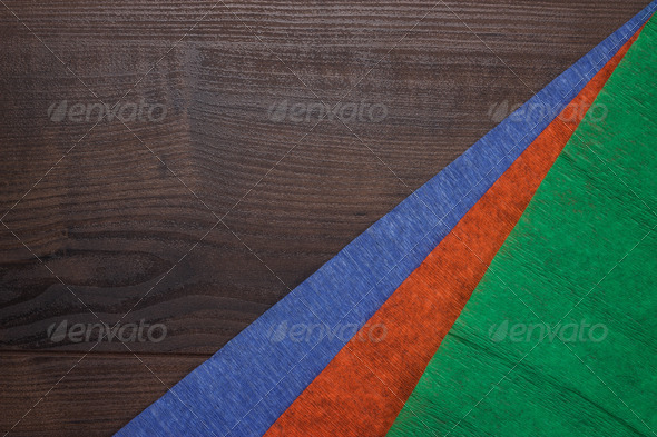 PhotoDune Red Green And Blue Jammed Paper On Wooden Background 3826796