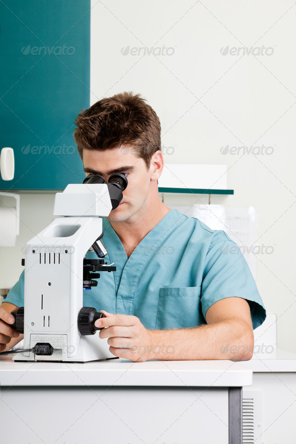 PhotoDune Male Researcher Using Microscope In Laboratory 3838468