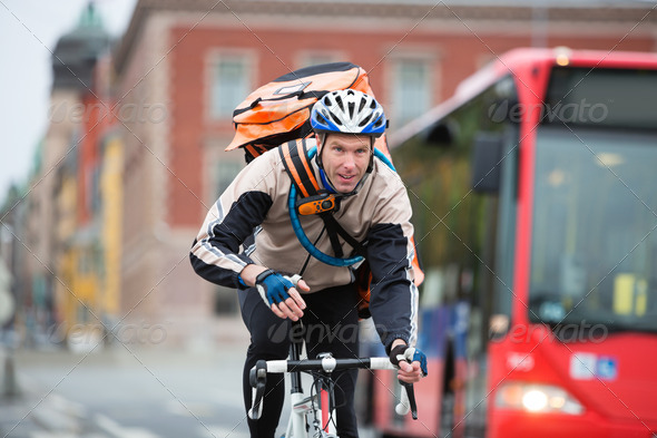 Male Cyclist With Courier Delivery Bag Riding Bicycle - Stock Photo - Images