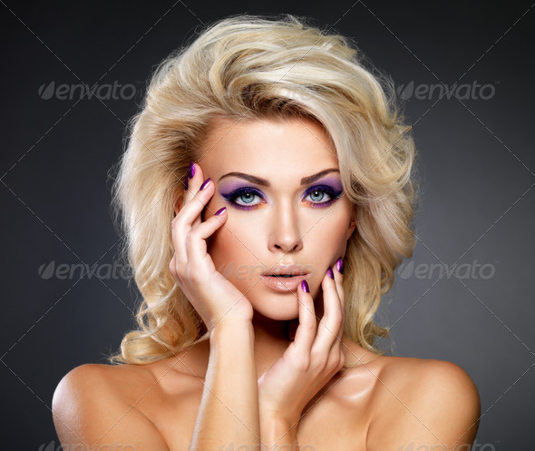 Beautiful woman with beauty purple manicure and makeup of eyes. - Stock Photo - Images