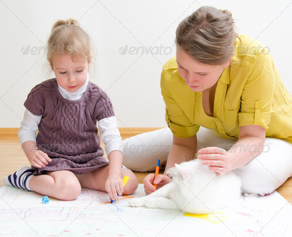 PhotoDune Young woman and little girl drawing together sitting on the floor 3853385
