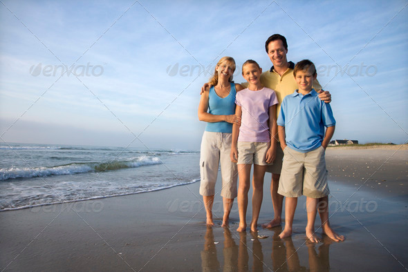 Smiling family on beach - Stock Photo - Images