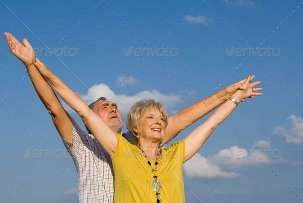 PhotoDune healthy active christian senior couple arms raised in praise 3866281