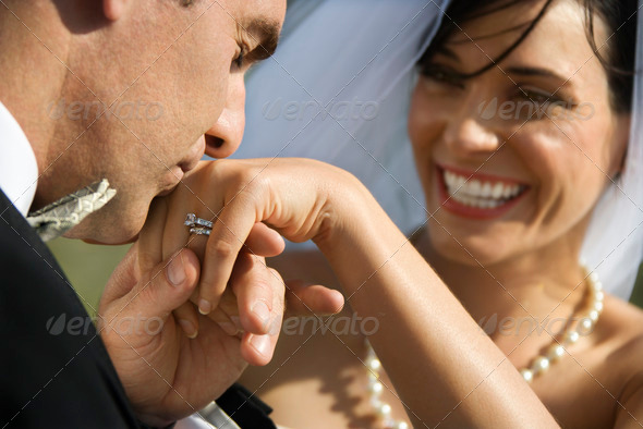 PhotoDune Groom kissing hand of bride 416615