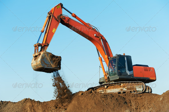 track-type loader excavator at work - Stock Photo - Images