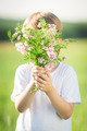 Boy hiding by bouquet - PhotoDune Item for Sale