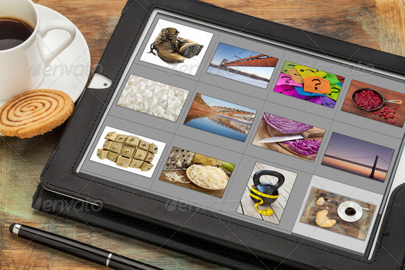 viewing pictures on digital tablet - Stock Photo - Images