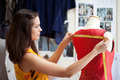 Fashion designer measuring a dress. Shallow depth of field. - PhotoDune Item for Sale