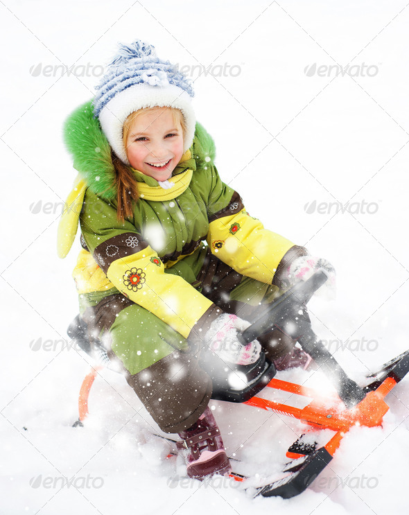 girl sledding - Stock Photo - Images