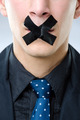 Man with black tape over his mouth - PhotoDune Item for Sale