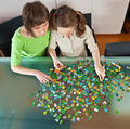 Girl and mom doing puzzle - PhotoDune Item for Sale
