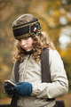 Teenager girl texting with cellphone in an autumn day - PhotoDune Item for Sale