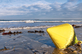 Yellow Marker Buoy at Low Tide on a Wet Sand Beach - PhotoDune Item for Sale
