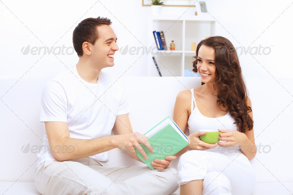 Young happy couple at hone together s - Stock Photo - Images