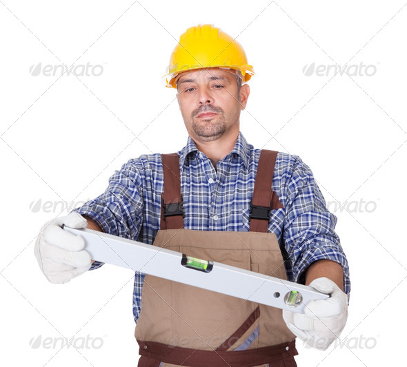 Portrait Of Technician Looking At Level - Stock Photo - Images