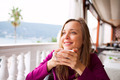Woman in a restaurant is drinking coffee - PhotoDune Item for Sale