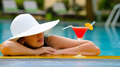 girl with a cocktail at the edge of the swimming pool - PhotoDune Item for Sale