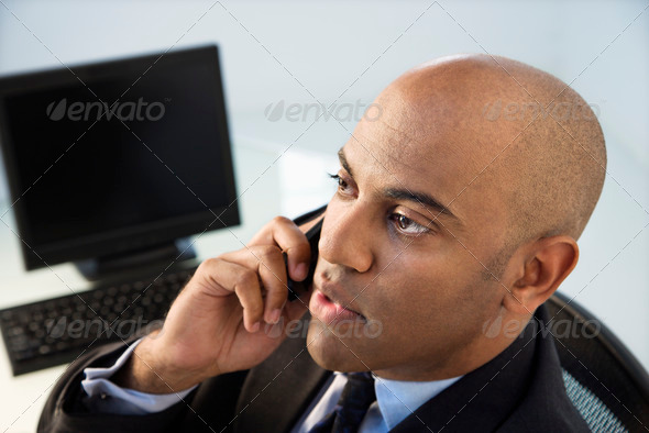 Businessman on phone - Stock Photo - Images