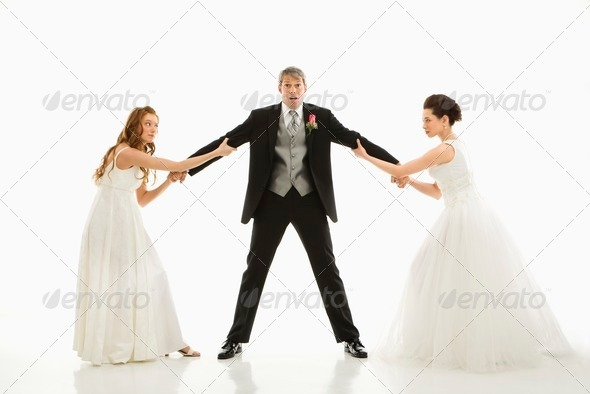 Brides fighting over groom - Stock Photo - Images