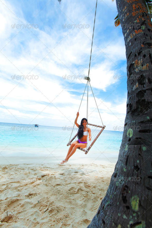 Womain in beach hammock - Stock Photo - Images