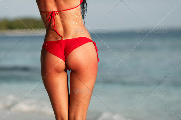 Sexy woman back on sea background - Stock Photo - Images