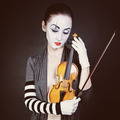 Sad mime with violin - PhotoDune Item for Sale