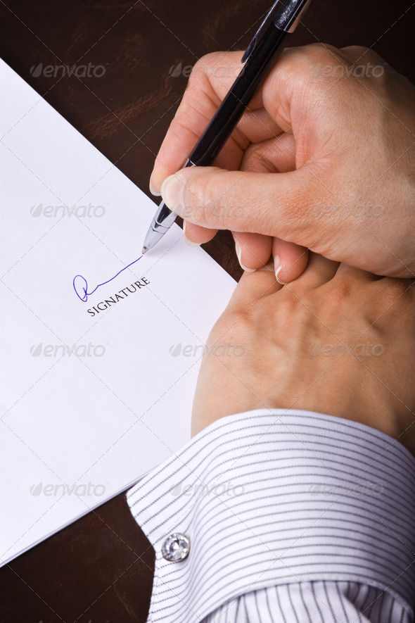 PhotoDune Human hand with pen signing a document 3969946