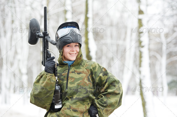 paintball player with marker at winter outdoors - Stock Photo - Images