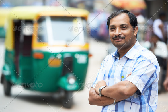 Indian auto rickshaw tut-tuk driver man - Stock Photo - Images