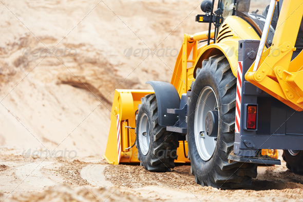 Excavator Loader at earth moving works - Stock Photo - Images