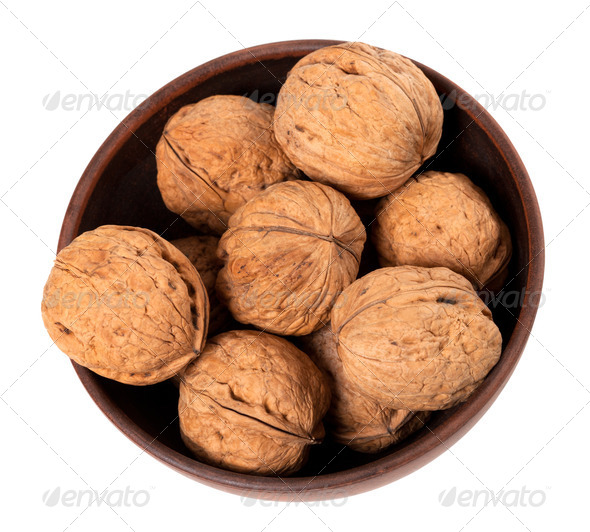Walnuts in ceramic bowl. Top view. - Stock Photo - Images