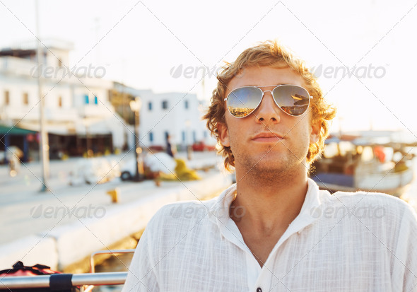 Handsome Young Man on Vacation at Sunset - Stock Photo - Images