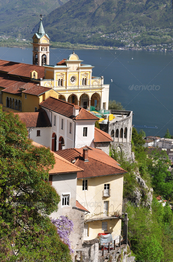 PhotoDune Madonna del Sasso medieval monastery on the rock overlook lake 4001865
