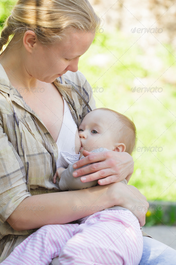 Mother breastfeeds - Stock Photo - Images