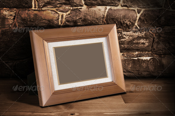 Frame on the shelf with place for photo 3 - Stock Photo - Images