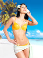 Woman with beautiful body in bikini at beach - PhotoDune Item for Sale
