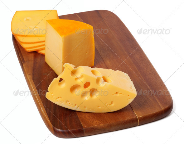 Cheeses on wooden kitchen board - Stock Photo - Images