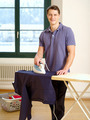 Attractive male ironing his shirt - PhotoDune Item for Sale