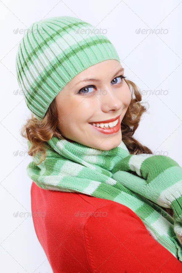 PhotoDune Young woman wearing winter hat and warm scarf 4048126