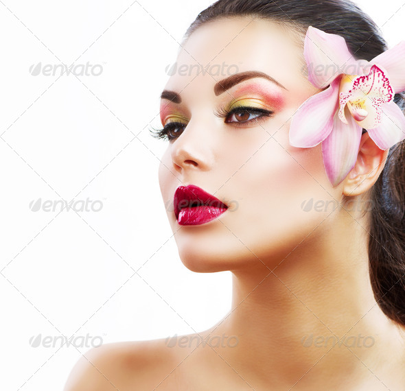 Beauty Portrait. Beautiful Stylish Girl with Orchid Flower - Stock Photo - Images