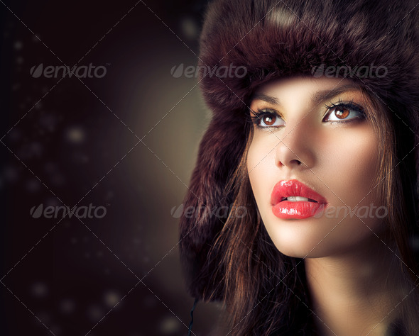 Beautiful Young Woman in a Fur Hat. Winter Style - Stock Photo - Images