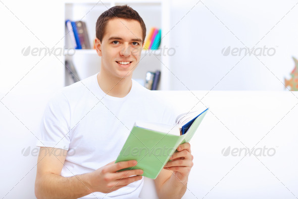 PhotoDune Young man at home with a book 4048134